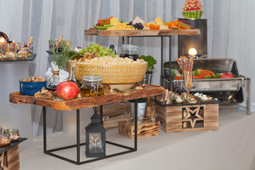 Buffet tray with fresh fruit, dry figs and grana padano cheese
