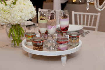Wedding catering food, cakes in champagne glasses