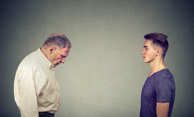 Young man looking at elder depressed himself