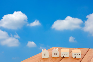 Miniature houses and blue sky : Image of housing