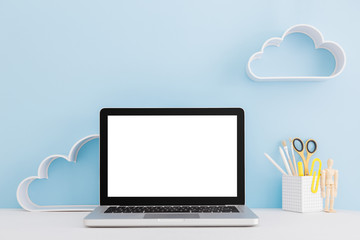 Laptop mock up. Creative desk with clouds decoration.