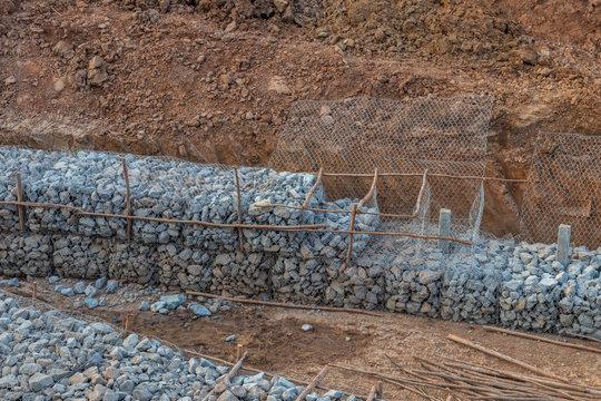 Stone in the mesh prevents erosion.