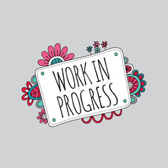 Work in Progress Sign with Flowers Doodle Vector on a grey background