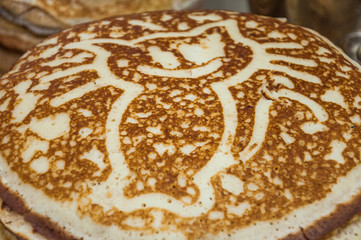 A variety of original pancakes with a picture of kitty in the contest during the celebration Russian Shrovetide (pancake week)