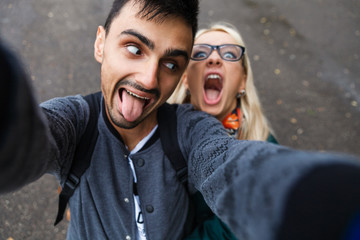 A couple in love grimaces.Couple makes a selfie