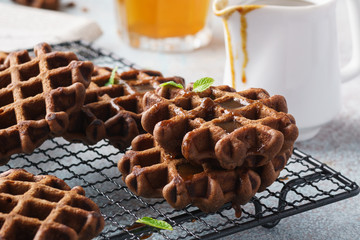 Chocolate Belgium waffles served with caramel syrup.