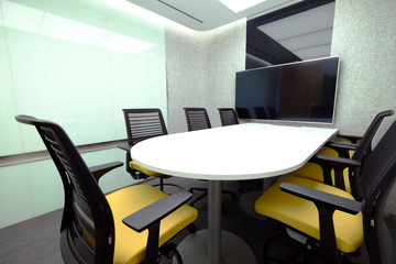 Small meeting room with whiteboard and television accessory for teleconference