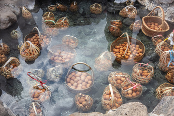 tourist boiling eggs in hot spring at Chae Son National Park Lampang, Thailand.