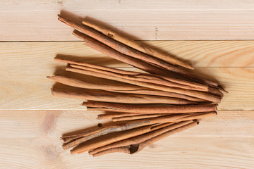 Top view of Cinnamon sticks on wood background, Asian nature aroma herb from bark.
