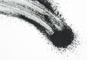 Abstract picture of activated charcoals powder on white background.