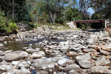 Almost dry, the creek bed is now a series of rocky waterholes.
