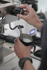Pouring Milk on The Coffee Machine