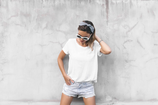 Woman in white t-shirt on grey background