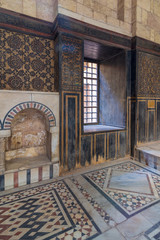 Wooden wall decorated with painted floral patterns, embedded arched niche and marble floor decorated with geometric patterns at ottoman era historic house of Moustafa Gaafar Al Seleehdar, Cairo, Egypt