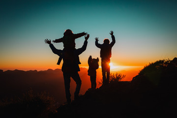 happy father with kids travel in sunset mountains, family hiking in nature