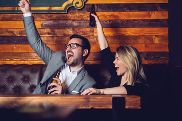Friends in the Pub. Drinking beer, talking, having fun.