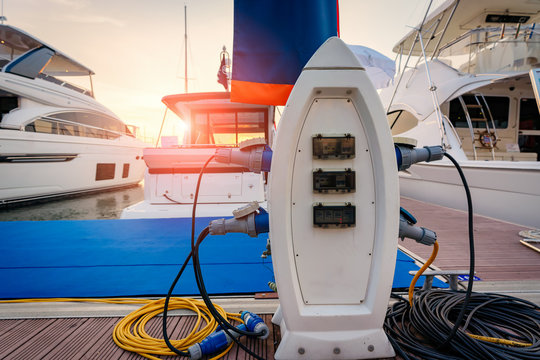 Charging station for boats, electrical outlets to charge ships in harbor.