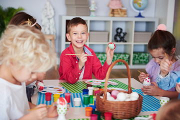 Group of children painting easter eggs
