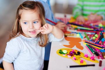 Adorable girl on art class