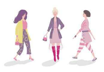Group of fashionable girls walking and posing