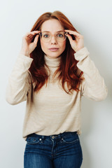 Young redhead woman wearing spectacles