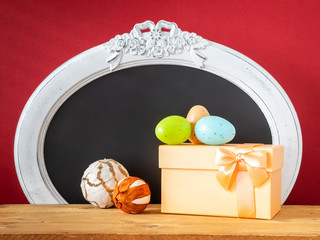 Easter decoration gift box eggs and vintage frame