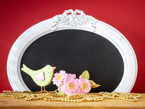 bird with a branch of blossoms easter holiday decoration background