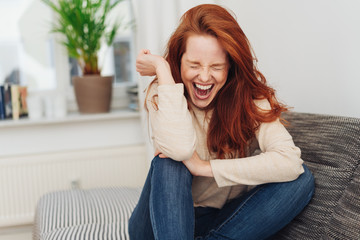 Ecstatic young woman cheering in jubilation