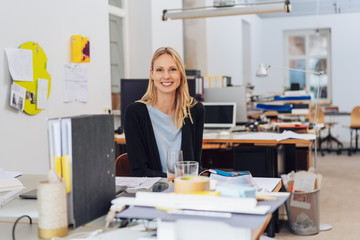 Happy young woman portrait in open space office