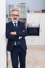 Front portrait of handsome mature man at home
