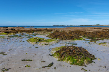 French landscape - Bretagne. A beautiful beach with rocks at low tide.
