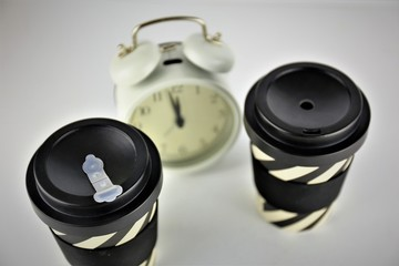 An Image of a coffee and a clock