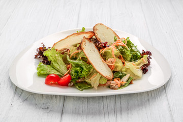 Fresh vegetables salad with croutons and chicken