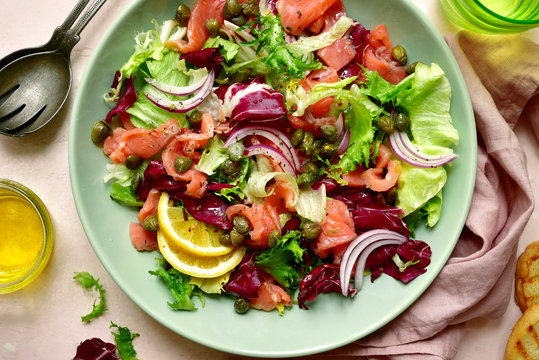 Mix of salad leaves with salted salmon. Top view with copy space.