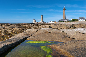 French landscape - Bretagne. The lighthouse Eckmühl at Saint-Pierre and a beautiful beach with rocks at low tide.