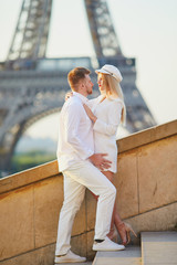 Romantic couple having a date near the Eiffel tower