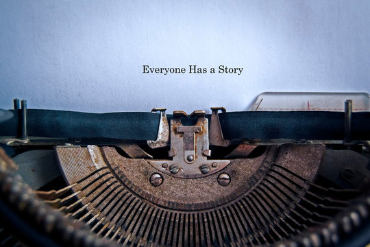 In the old typewriter inserted a white sheet of paper with the inscription: Everyone Has a Story