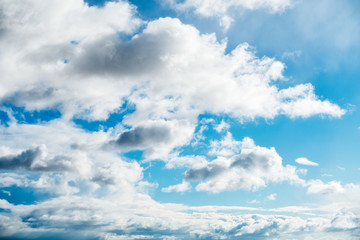 Blue Sky with White Clouds Illuminated by the Sun