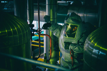 Man in a radiation protection suit. Wall mural