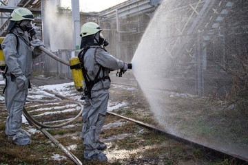 Firefighters in chemical protection suit. Wall mural