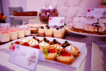 Delicious candy bar for special events. Beautiful candy bar of pink and white sweets decorated
