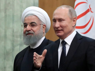 Iranian President Hassan Rouhani and Russian President Vladimir Putin meet in the Black sea resort of Sochi