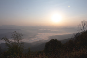 Layer of Mountain in morning sunrise and winter fog,
