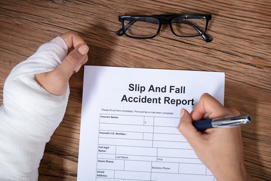 Woman Hand Filling The Slip And Fall Injury Report