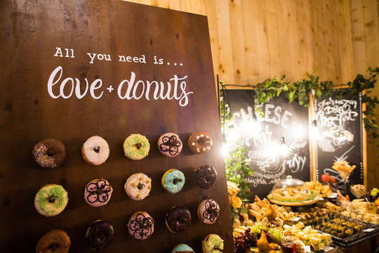 Delicious donuts on wooden stander