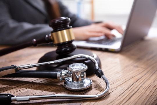 Mallet And Stethoscope On Gavel Over The Office Desk