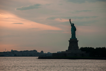 Silhouette of Statue of Liberty at beautiful sunset