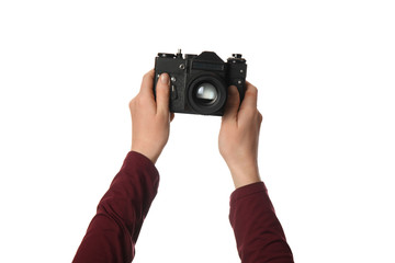 Vintage camera in hand isolated on white background. Photography and memories.