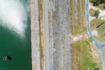 Aerial photo from flying drone of asphalt road and bicycle lane around the dam,beautiful nature landscape in phuket thailand