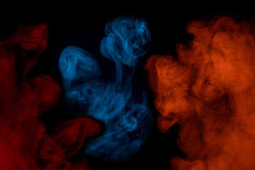 multicolored cigarette vapor blue orange and red exciting patterns on a dark background